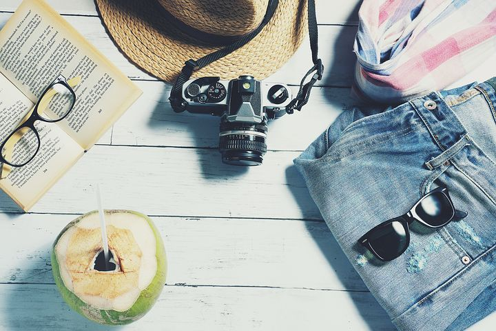 vacation stuff-jeans, sun glass, hat,camera,glass,scarf and coconut water