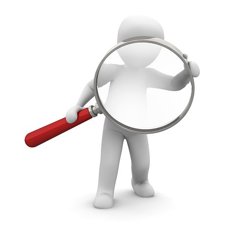 Magnifying glass carried by animated human like figure