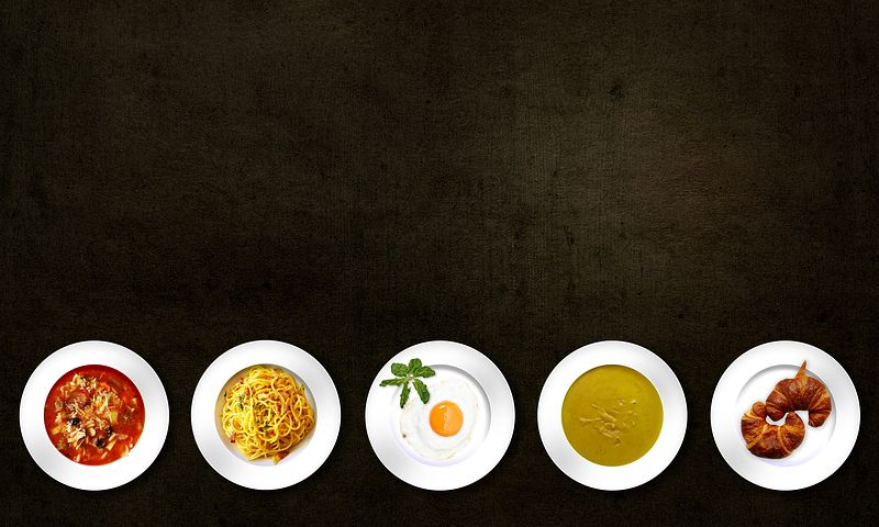 5 Plates of different types of food in black background