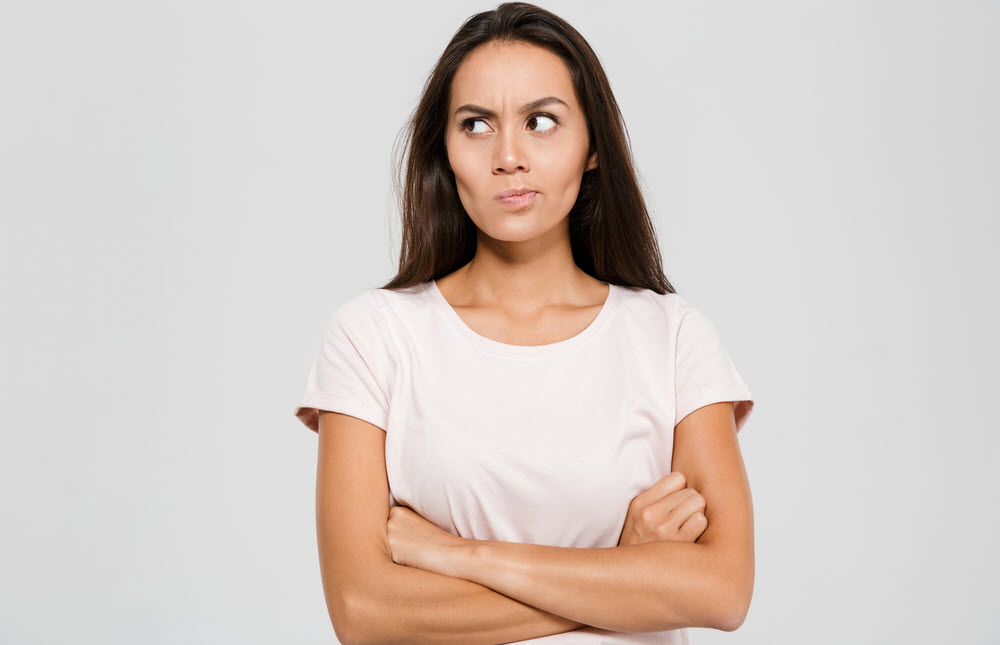 Woman looking mad and crossing her arms