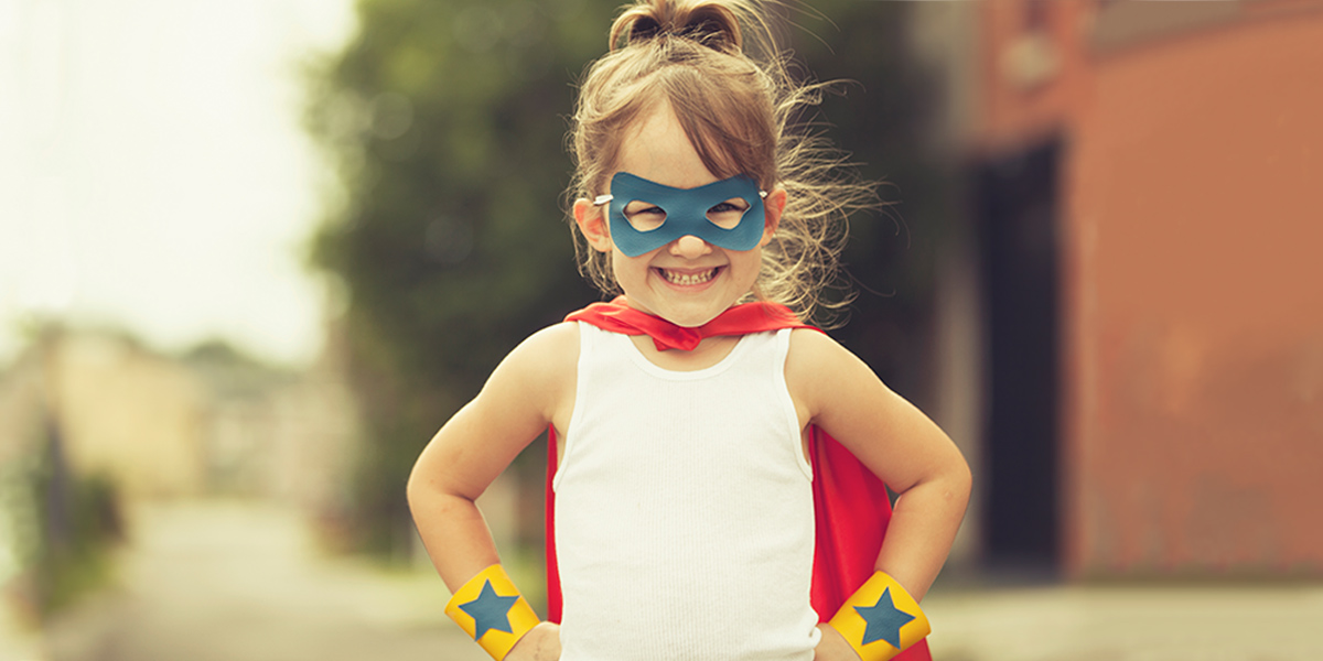 small girl dressed as superhero