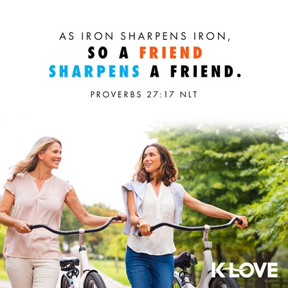 'As Iron Sharpen iron. so a friend sharpens a friend' quote image with two ladies smiling and walking with bicycle