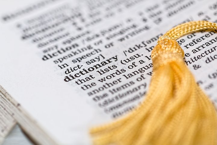Open page of Dictionary  with tessle bookmark