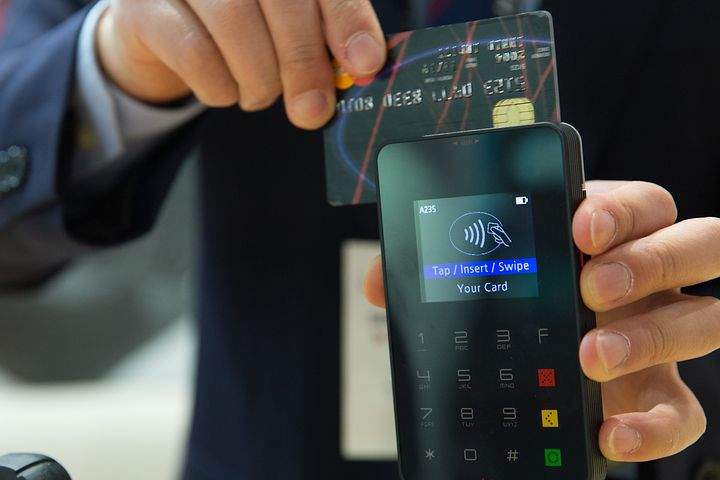 swiping credit card in a paying machine