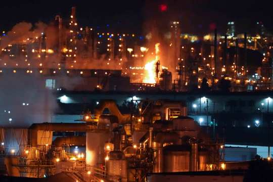 A fire burns after an explosion at the Marathon Refinery in Carson