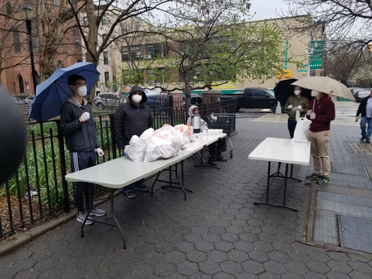 Volunteers with Graffiti Church in New York City hand out meals to people in need i