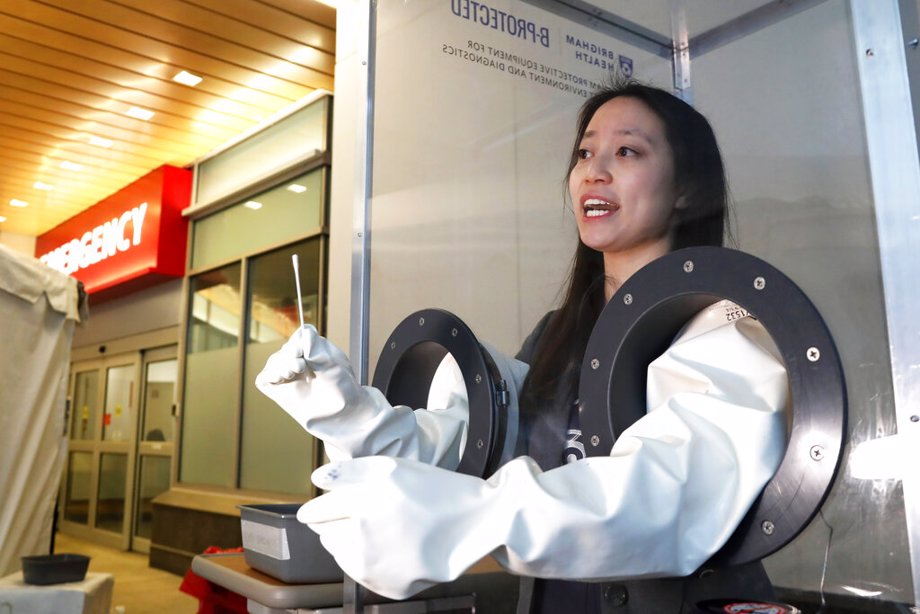 Dr. Sherry Yu demonstrates a free-standing booth for COVID-19 testing