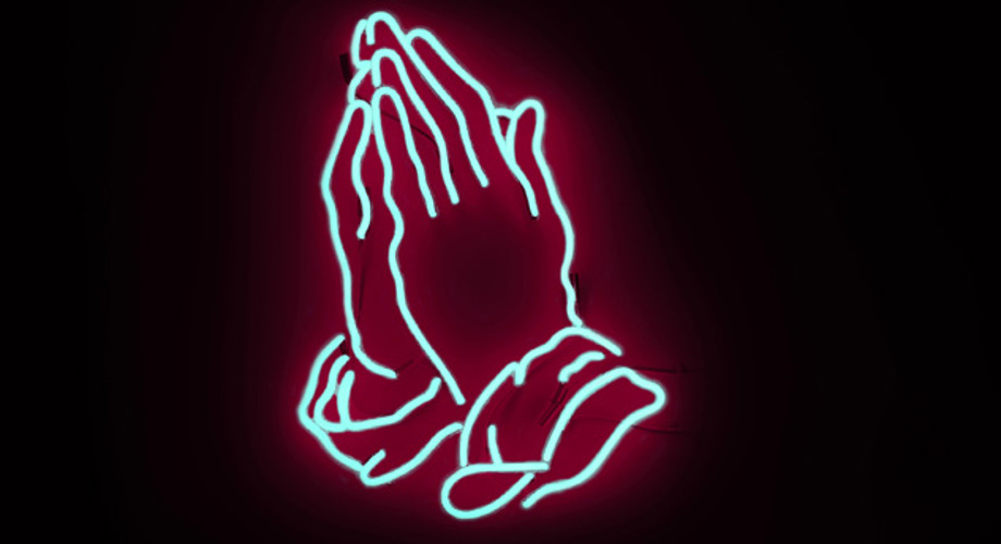 Neon praying hands