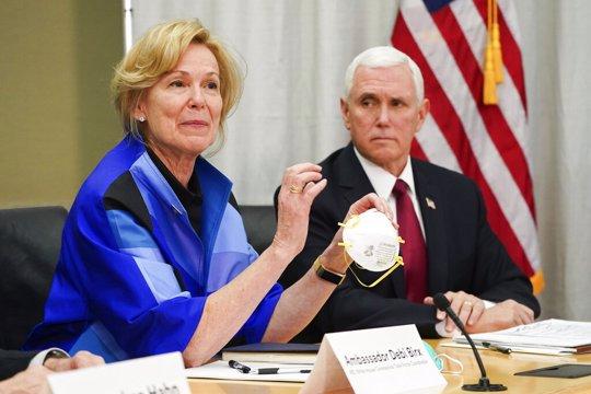 Dr. Deborah Birx, Ambassador and White House coronavirus response coordinator, holds a 3M N95 mask