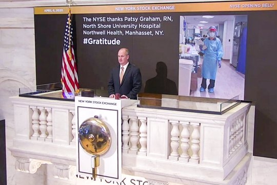 Chief Security Officer Kevin Fitzgibbons rings the opening bell at the NYSE, Monday, April 6, 2020, recognizing Patsy Graham, a registered nurse at North Shore University Hospital Northwell Health, in Manhasset, NY