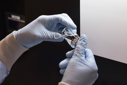 Vial of the experimental drug remdesivir visually inspected