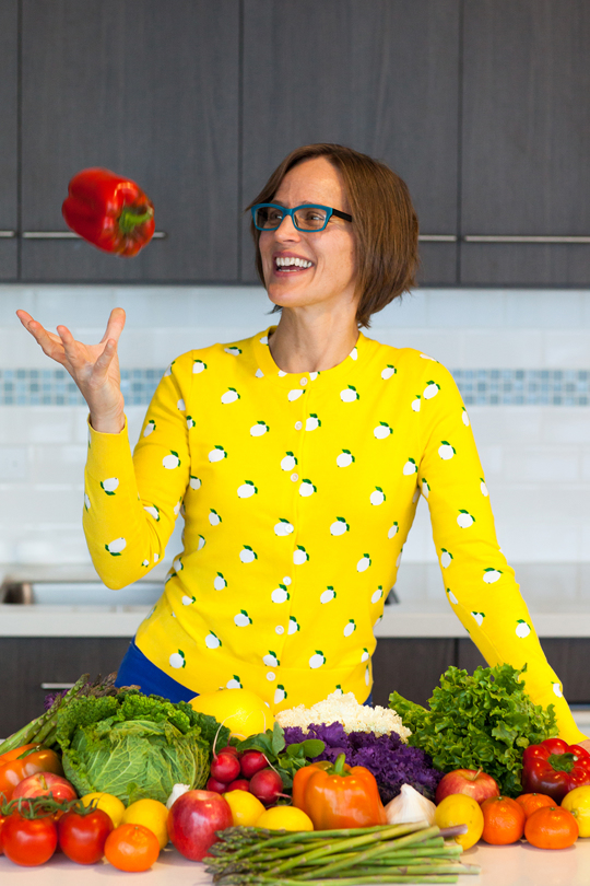 Food Literacy Center's founder Amber Stott tosses up a red bell pepper