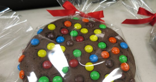 plastic-wrapped chocolate cookies with M and M's and red bow