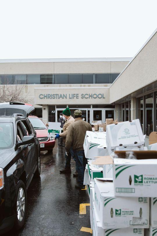 Volunteers loading free groceries into cars