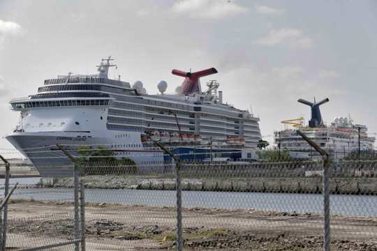 Carnival Cruise ships are docked at the Port of Tampa in Tampa, Fla.