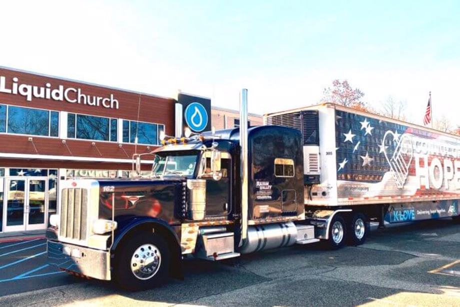Big rig filled with food outside a church