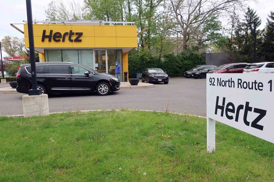 Van outside Hertz car rental office