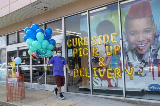 Party City Employee Delivers Baloons To Curbside Customer