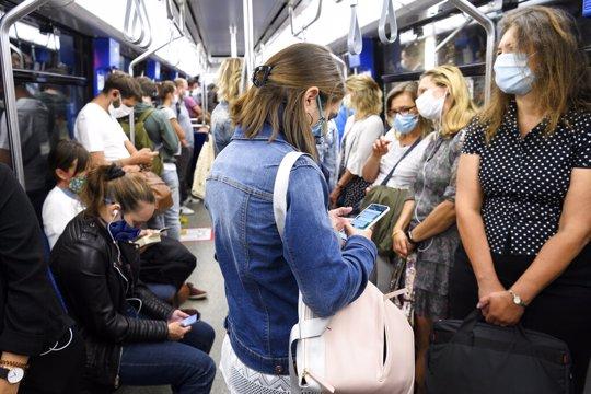 People wearing masks in Subway