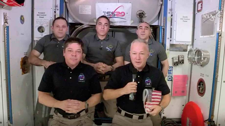 This photo provided by NASA shows, from left, front, astronauts Bob Behnken and Doug Hurley during an interview on the International Space Station on Saturday, Aug. 1, 2020.