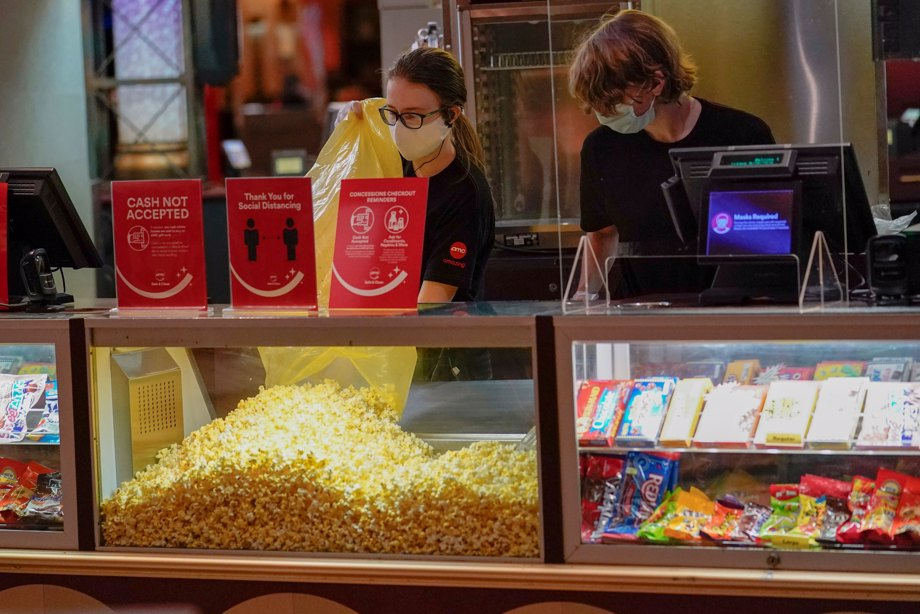 Concessions workers stock the bins with popcorn and other treats