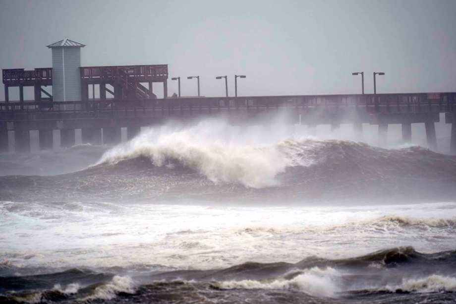 Waves crash near a pier, at Gulf State Park, Tuesday, Sept. 15, 2020, in Gulf Shores, Ala.