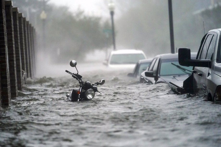 Flood waters move on the street in Pensacola, Fla.