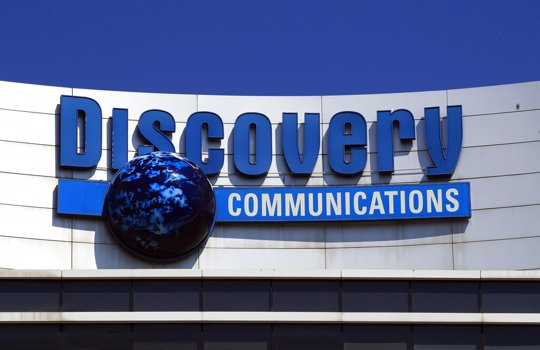 Discovery Communications logo sits atop its headquarters