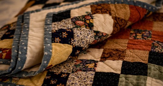 Quilt with various patches of color
