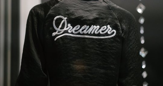 "Black jacket with ""Dreamer"" Stitched into material"