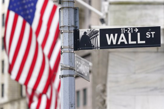 Street sign displayed at the New York Stock Exchange in New York