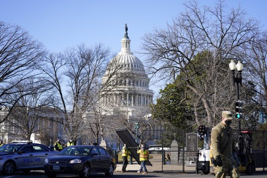 Workers install no-scale fencing at the US Capitol