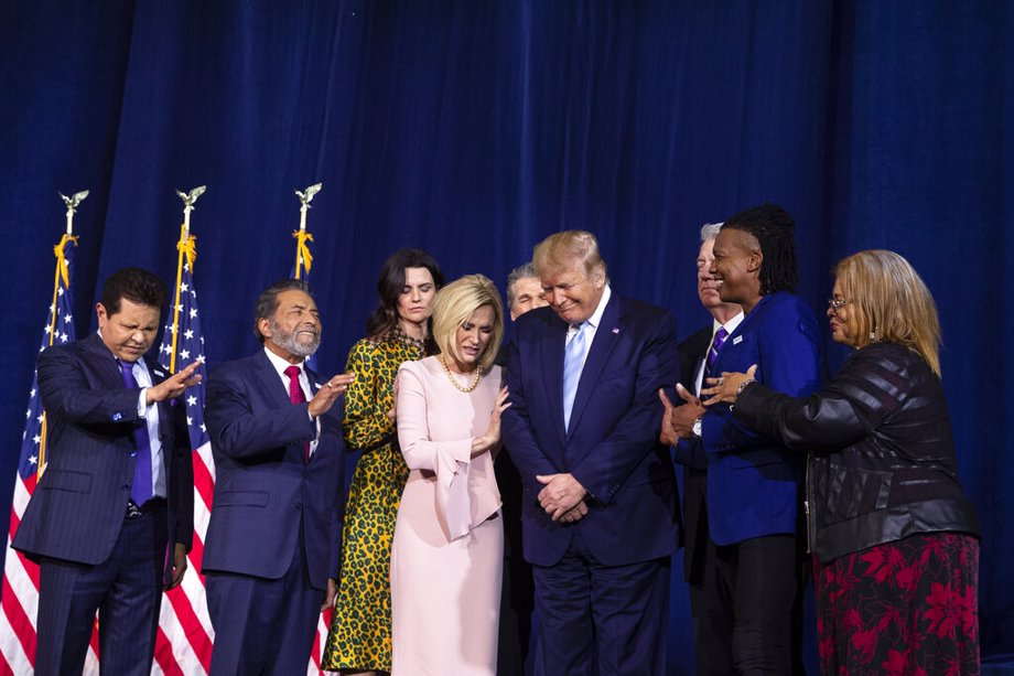 """(1/3/20) Faith leaders pray over President Donald Trump during an """"Evangelicals for Trump Coalition Launch"""" at King Jesus International Ministry in Miami."""