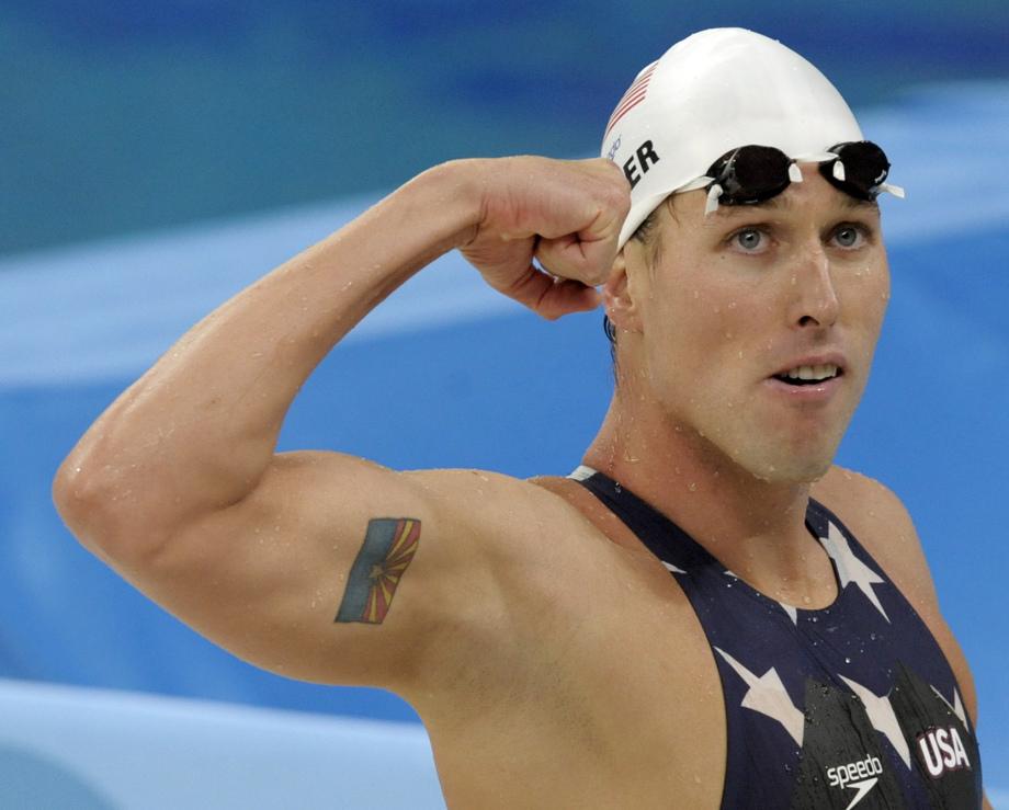 Olympic Swimming Medalist Klete Keller flexing bicep