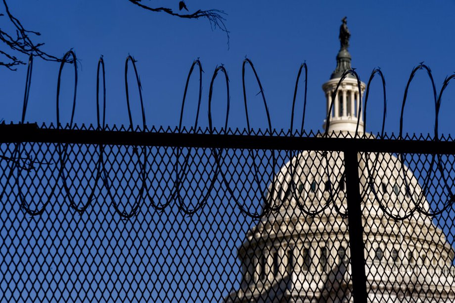 Capitol Building with razor wire fence