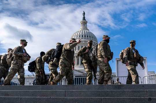 National Guard troops reinforce security around the U.S. Capitol ahead of the inauguration of President-elect Joe Biden and Vice President-elect Kamala Harris, Sunday, Jan. 17, 2021, in Washington.