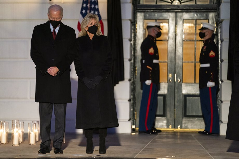 President Joe Biden and first lady Jill Biden participate in a moment of silence during a ceremony to honor the 500,000 Americans that died from COVID-19