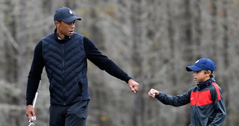 Tiger Woods fist bumping his son Charlie, 11-years-old