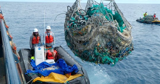 A crew with a boatload of marine plastic and abandoned fishing nets