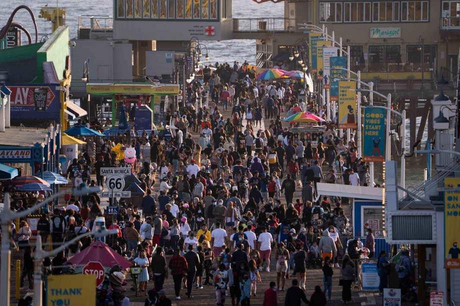 people gather on the Santa Monica Pier in Santa Monica, Calif.
