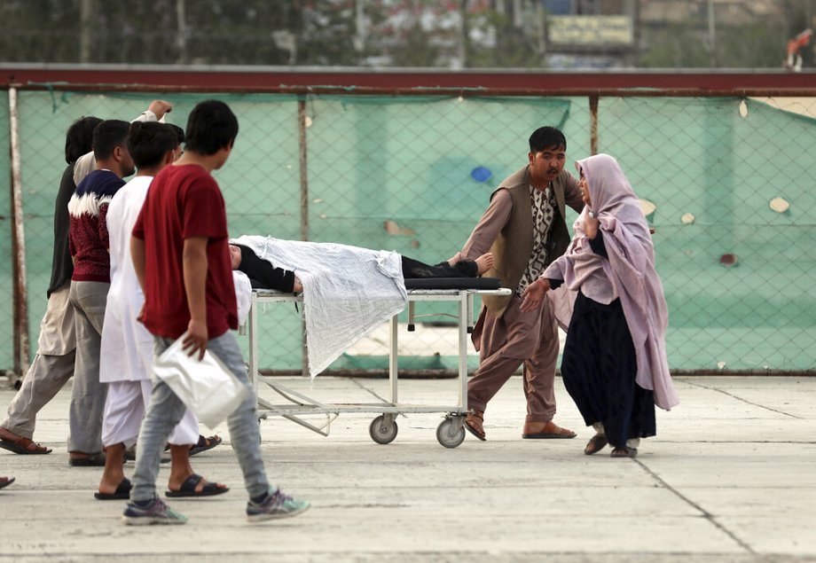 An injured school student is transported to a hospital after a bomb explosion near a school west of Kabul, Afghanistan