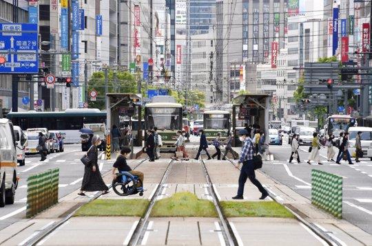 People wearing face masks make their way in Hiroshima