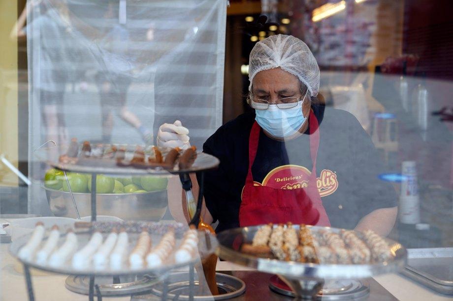 a worker wears a mask