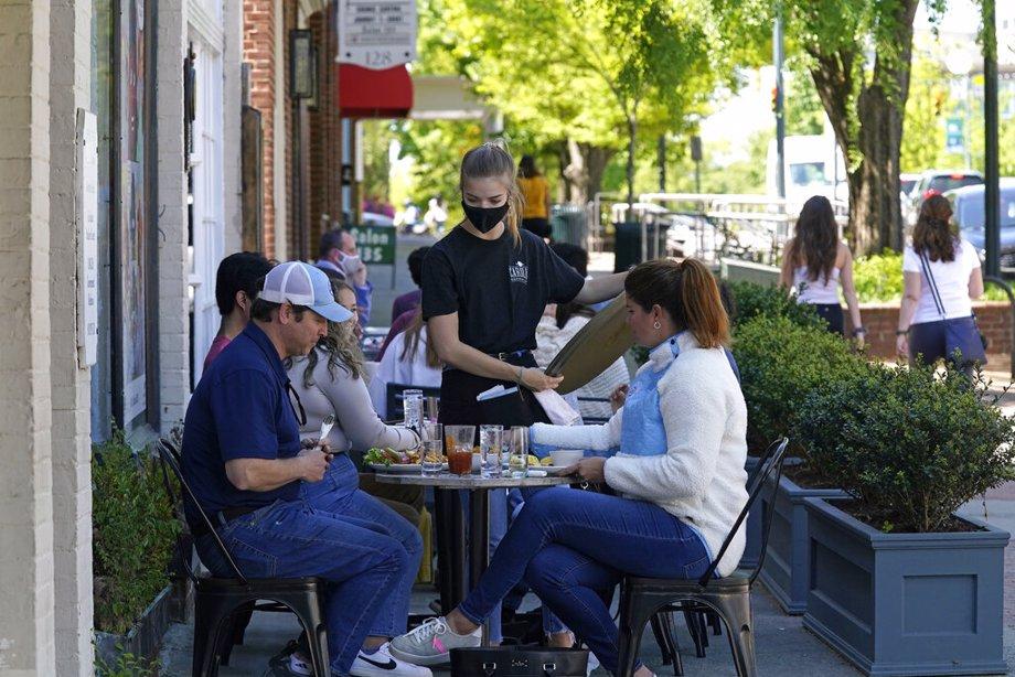 Dining along a sidewalk on Franklin Street in Chapel Hill, N.C.,