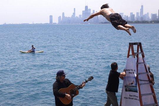 """Dan O'Conor, the """"Great Lake Jumper,"""" makes his 365th leap into Lake Michigan"""