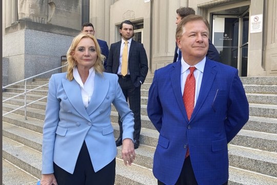 Patricia McCloskey, left, and her husband Mark McCloskey leave a court in St. Louis