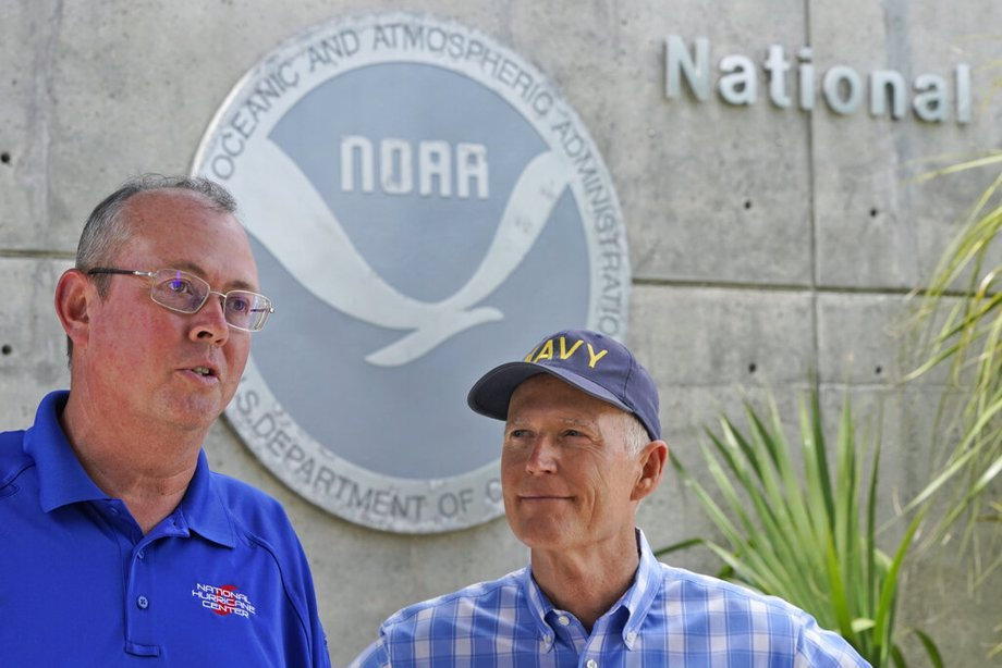 National Hurricane Center director Ken Graham, left, speaks during a news conference along with Sen. Rick Scott, R-Fla.,Tuesday, June 1, 2021, at the center in Miami. Tuesday marks the start of the 2021 Atlantic hurricane season which runs to Nov. 30.