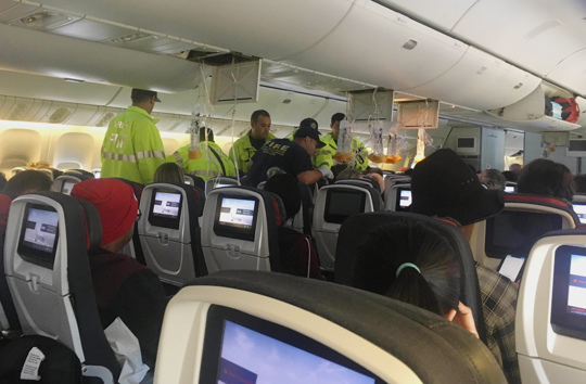 emergency personnel on plane