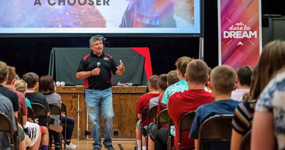 Randy Rich talks to a school assembly