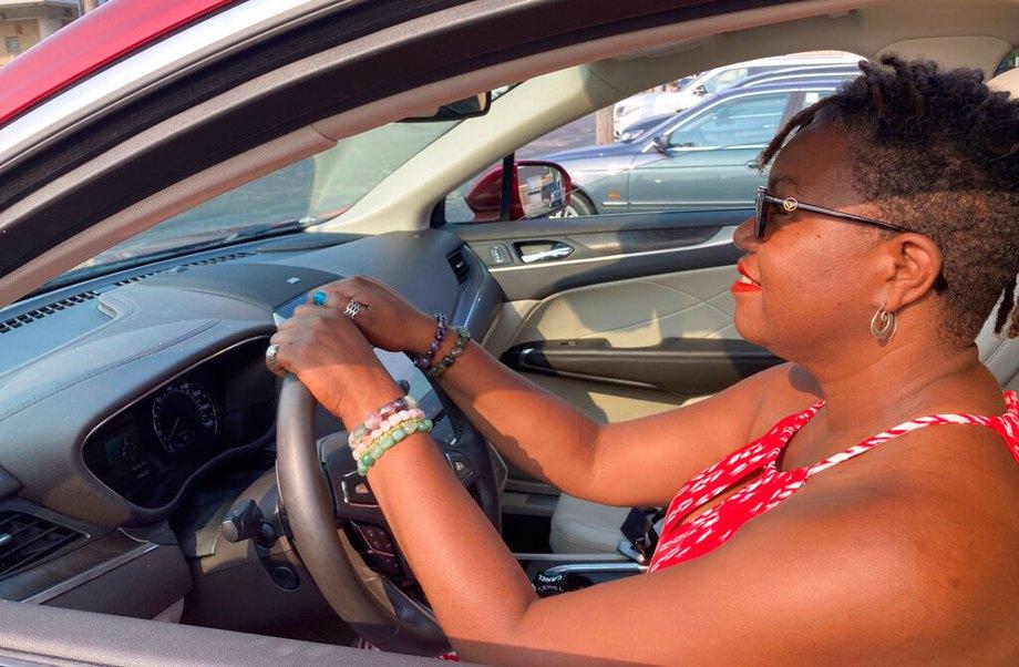 Woman test driving car